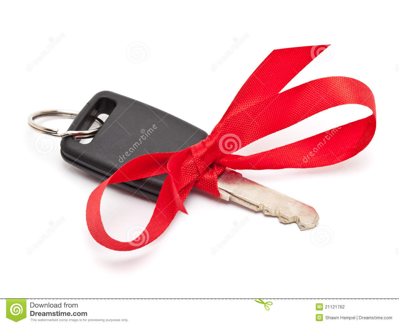 Car key with red bow as a present over white background.