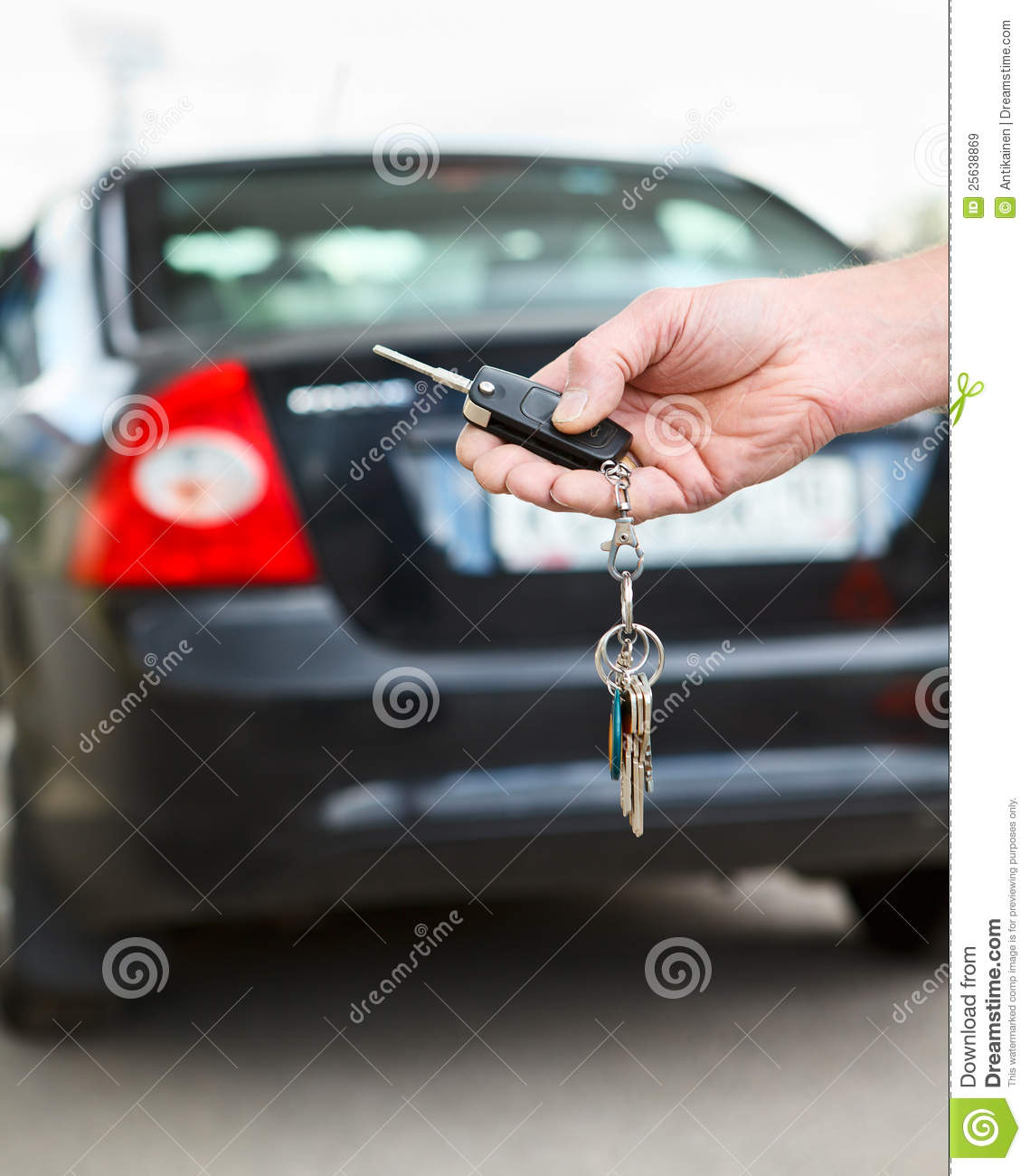 Drivers Awake To Find Cars Keyed In Penwortham: Car Key With Remote Control In Hand Royalty Free Stock