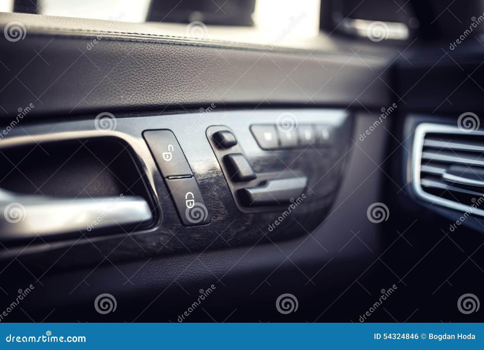 car leather interior details of door handle with windows controls seat adjustments modern. Black Bedroom Furniture Sets. Home Design Ideas