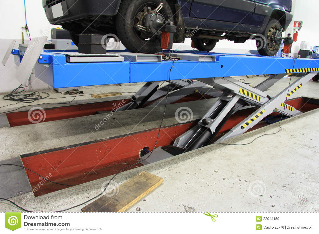 car lift at garage stock photo