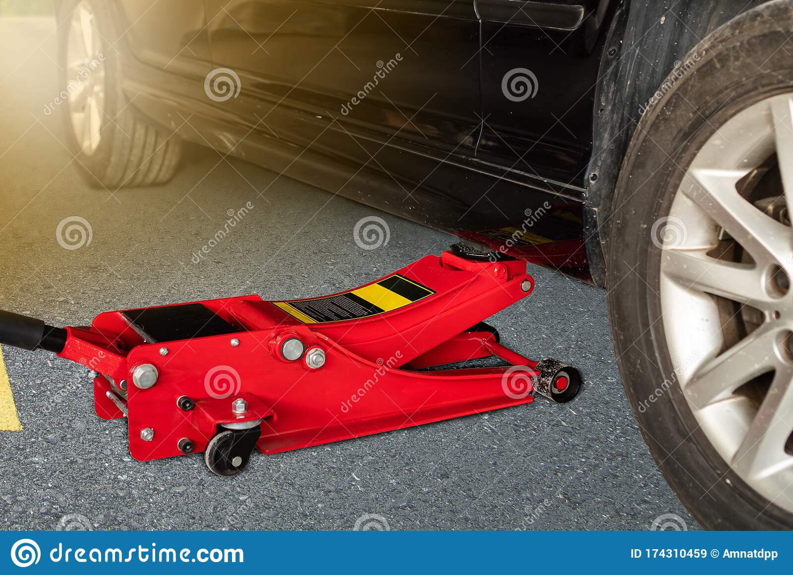 Hydraulic Car Jack To Lift Car For Change The Wheel Stock Image