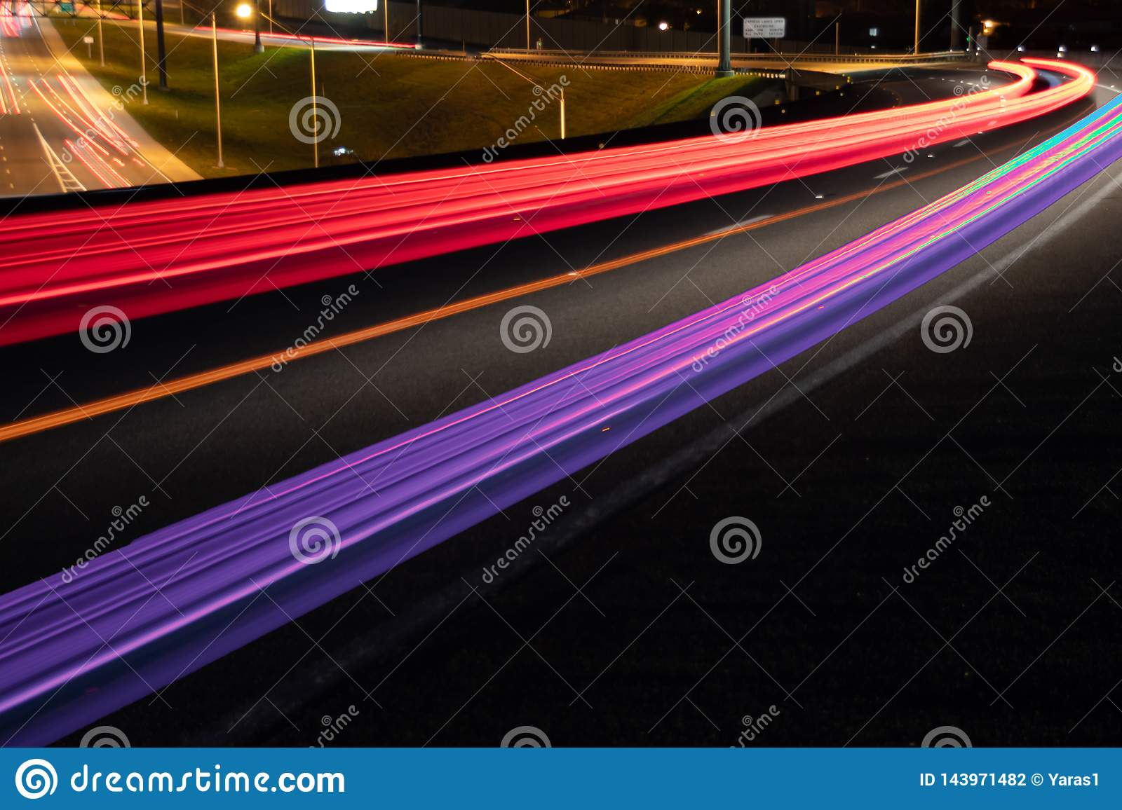 Car light trails on Interstate 75 at night time. Art image.