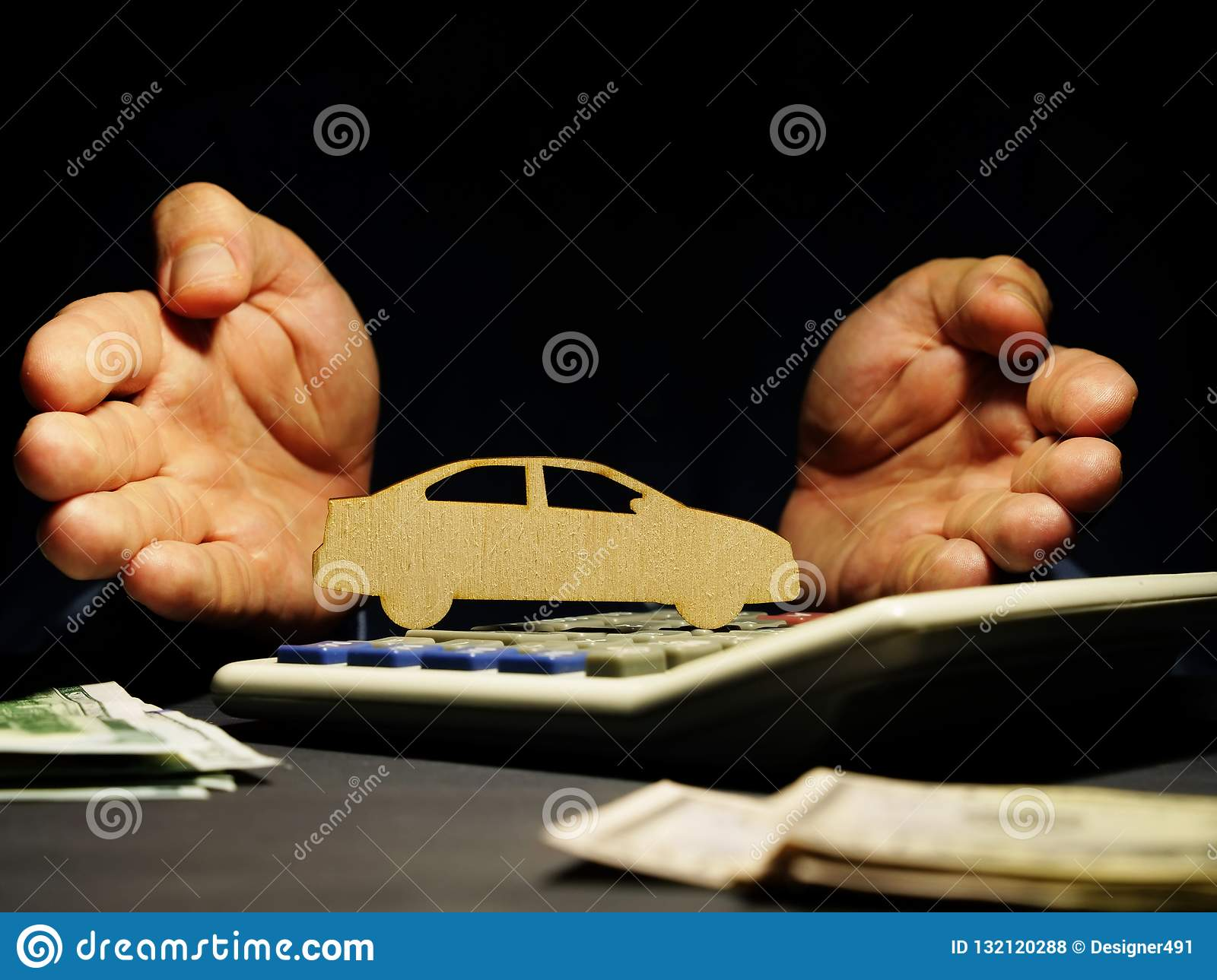 Car loan. Hands offers model of vehicle