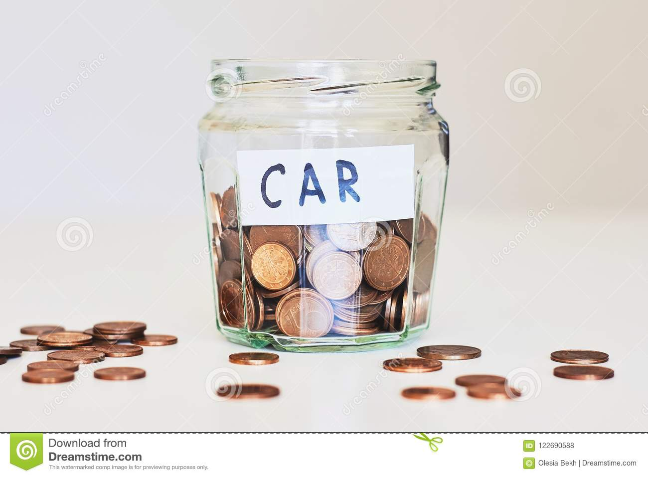 Car loan, car insurance concept. Glass jar full of coins and paper sign car