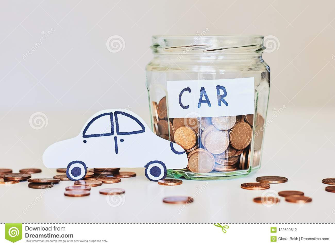 Car loan, car insurance concept. Glass jar full of coins and white paper car