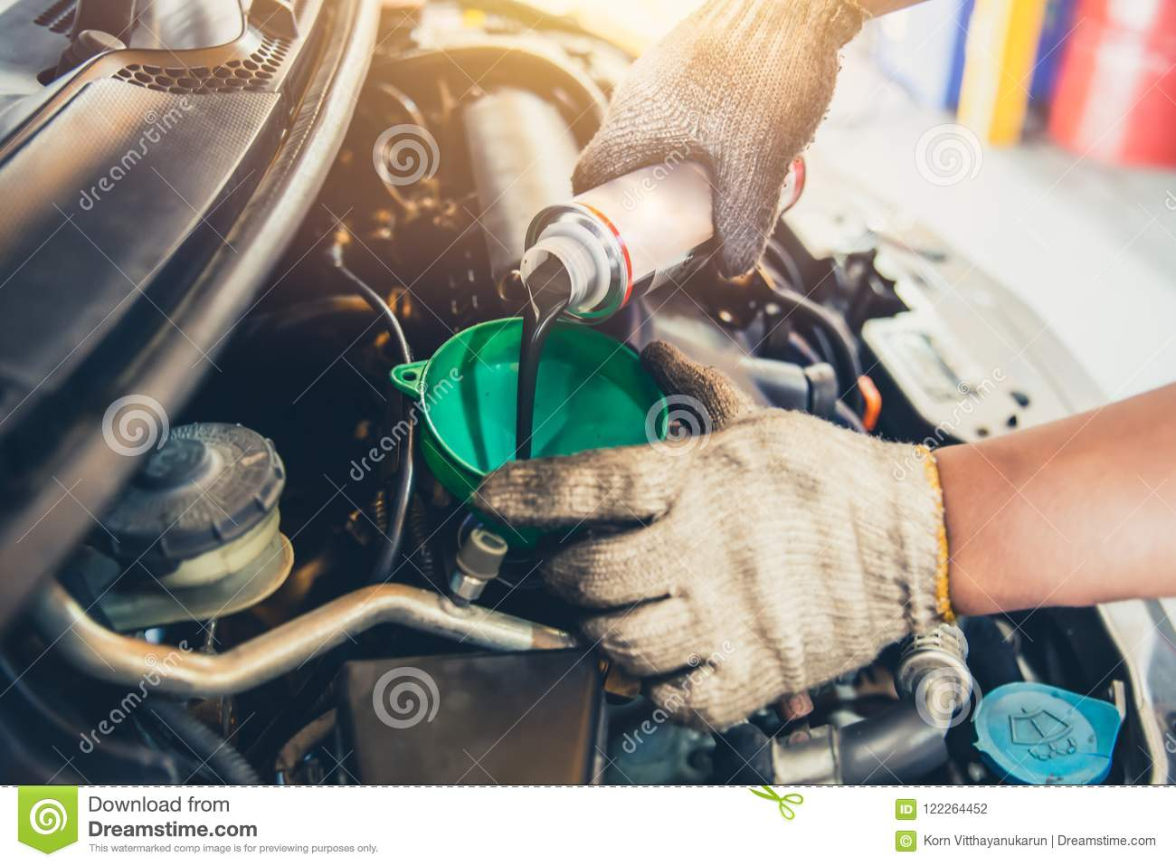 Car maintenance change oil and filling engine lube