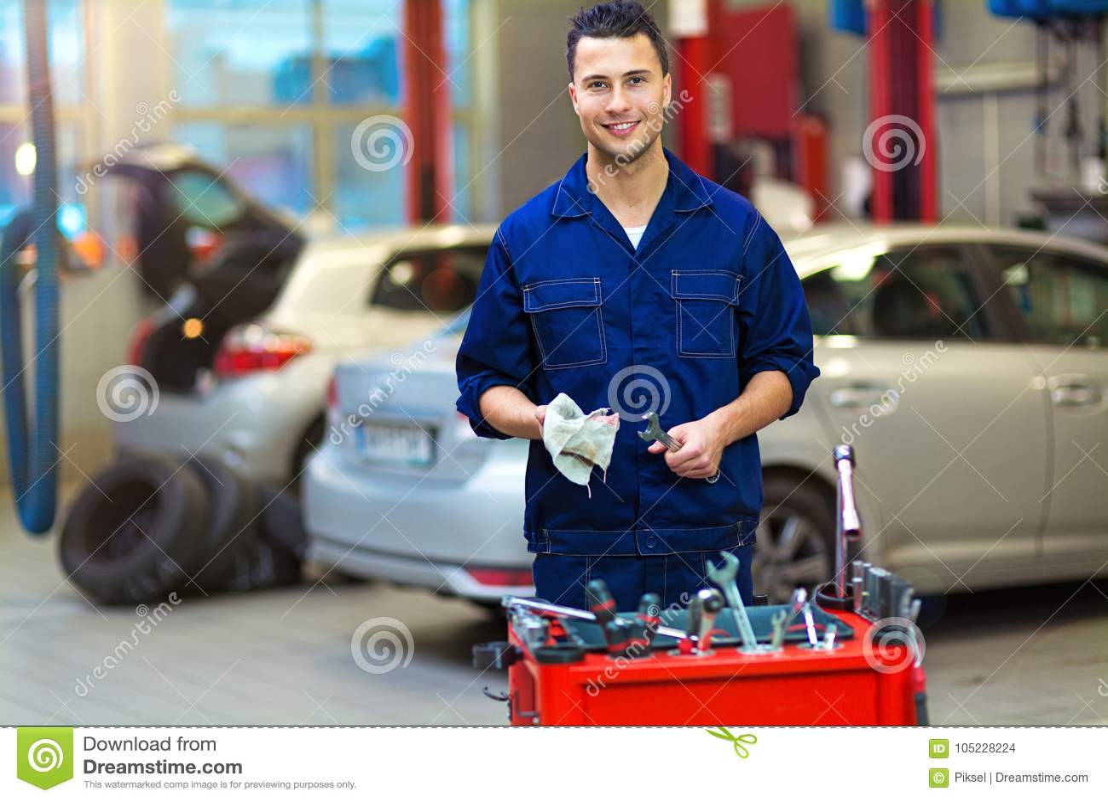 Car mechanic in auto repair shop