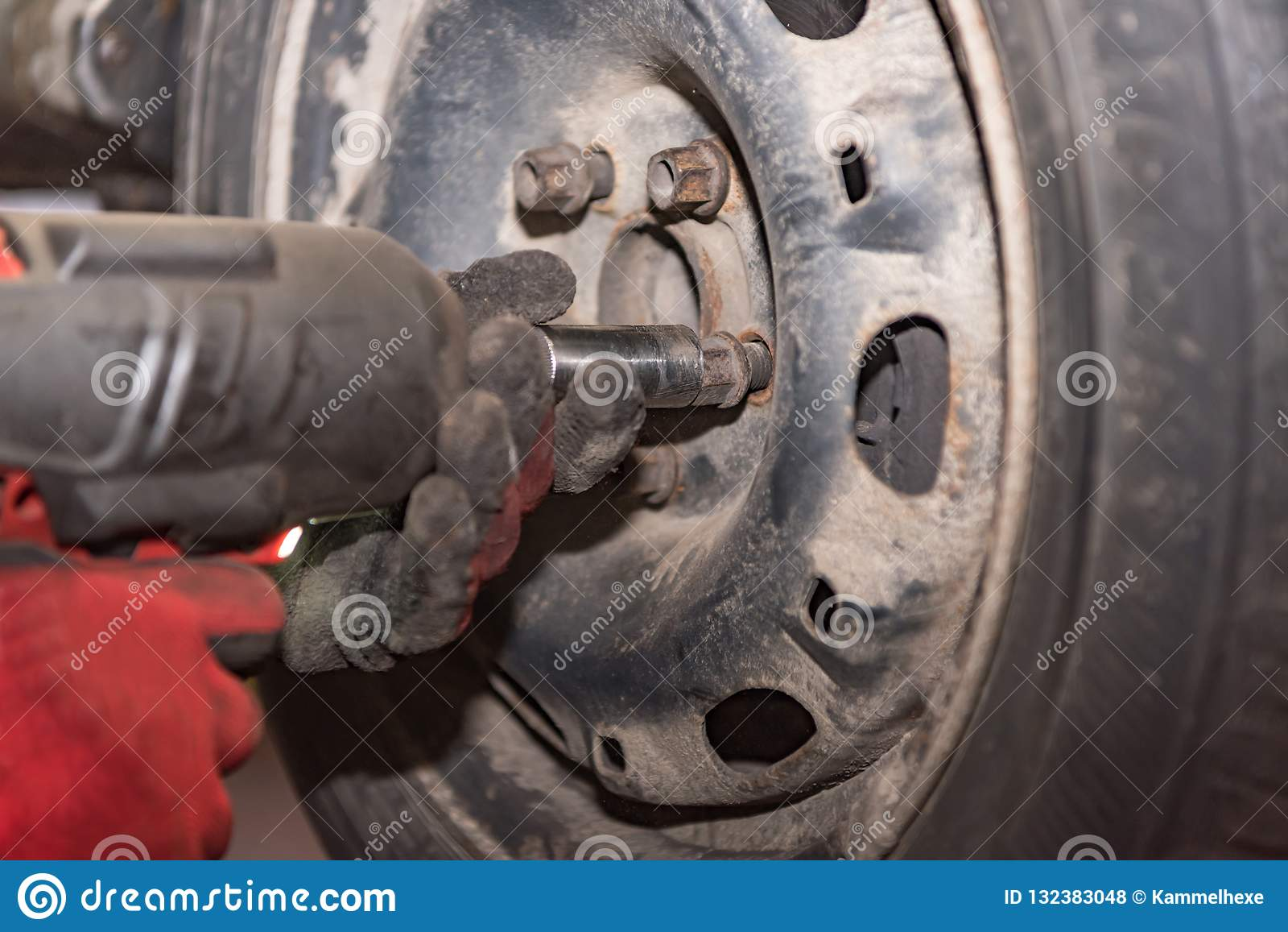 Mechatronics engineer changing the car tires