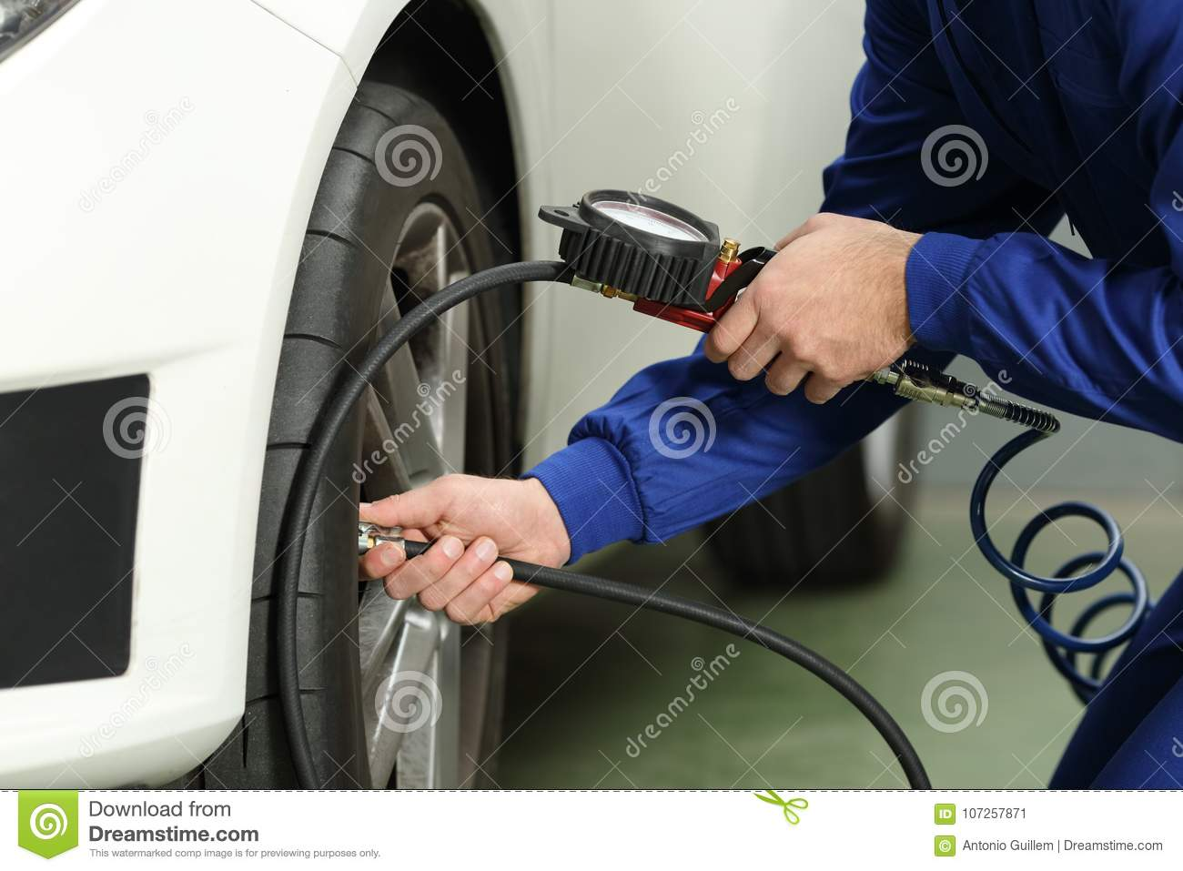 Car Mechanic Checking Tires Air Pressure Stock Image Image Of
