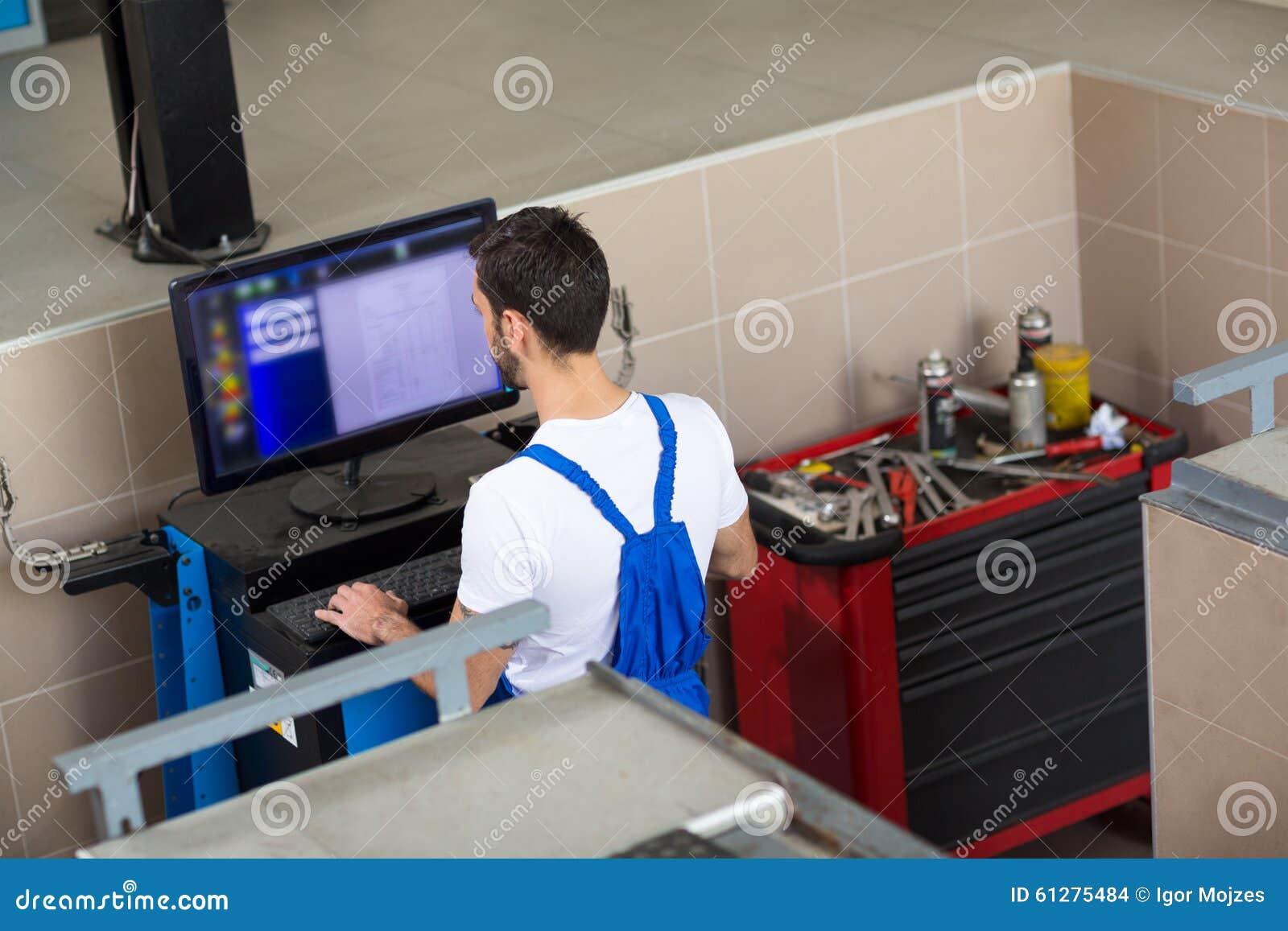 Car mechanic doing car diagnostic stock photo image for Motor vehicle diagnostic machine