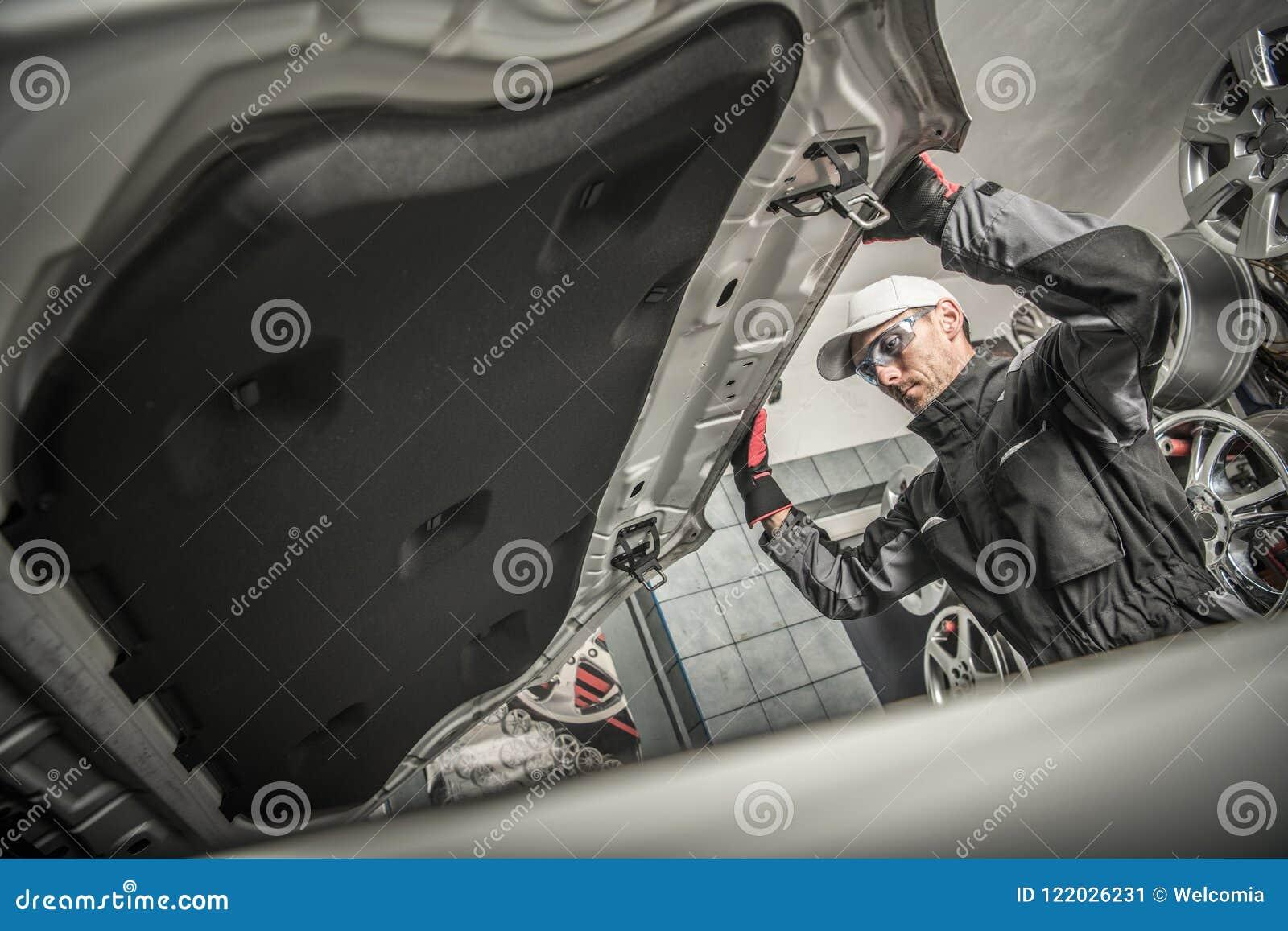 Car Mechanic Opening Hood
