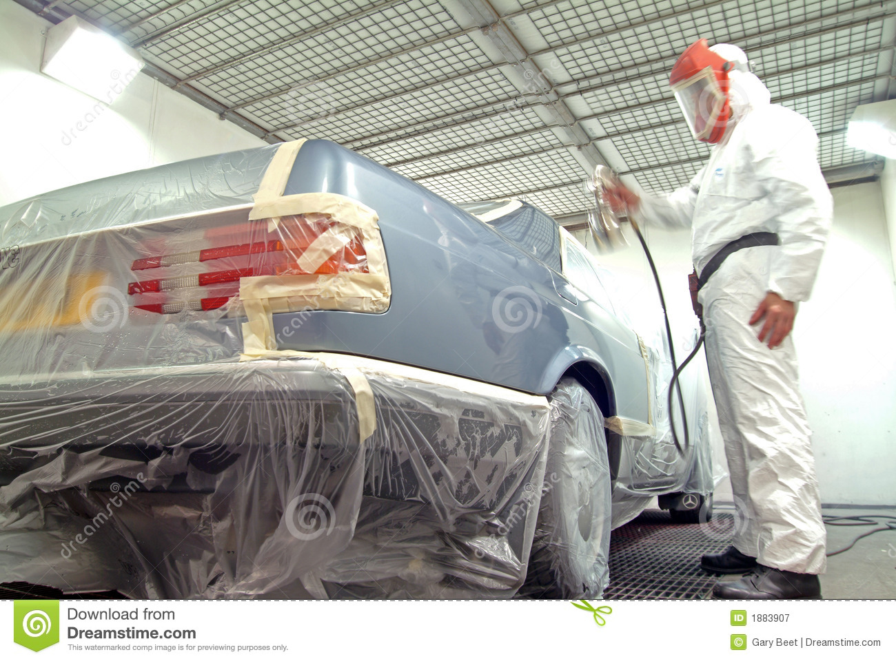 mechanic working on a car re spray. Black Bedroom Furniture Sets. Home Design Ideas