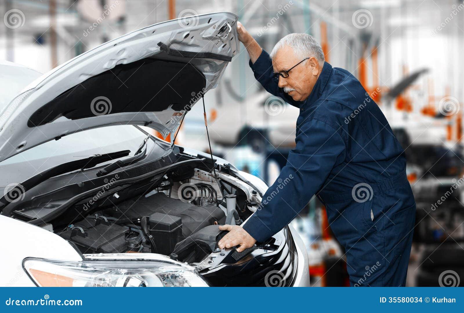 Car mechanic stock photo image of broken garage for Motor vehicle repair license