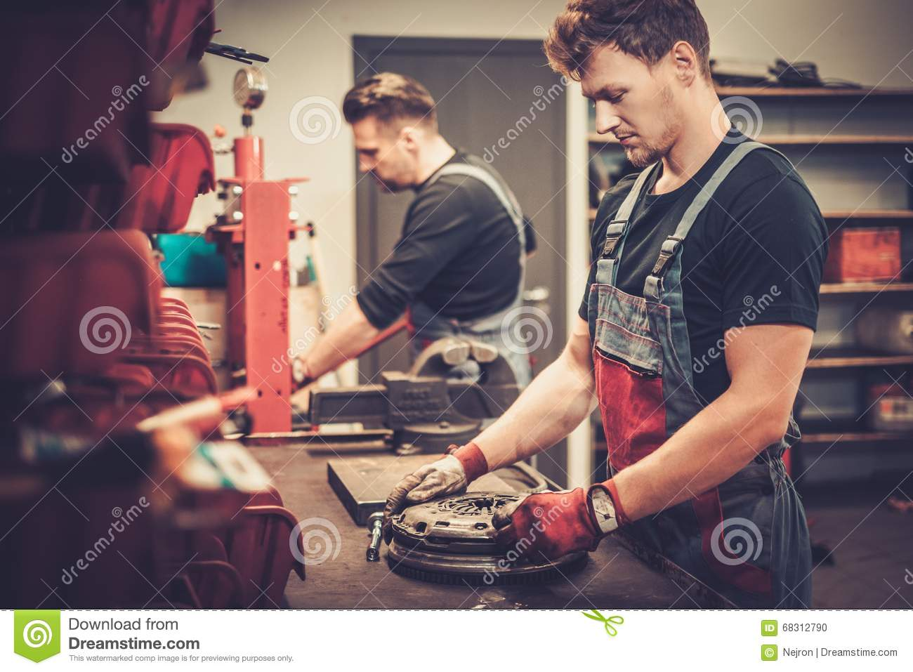 Car Mechanics Working At Work Table In Auto Repair Service ...
