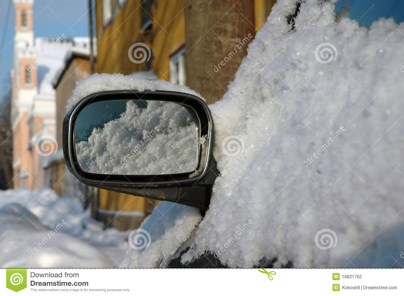 Car mirror covered of snow