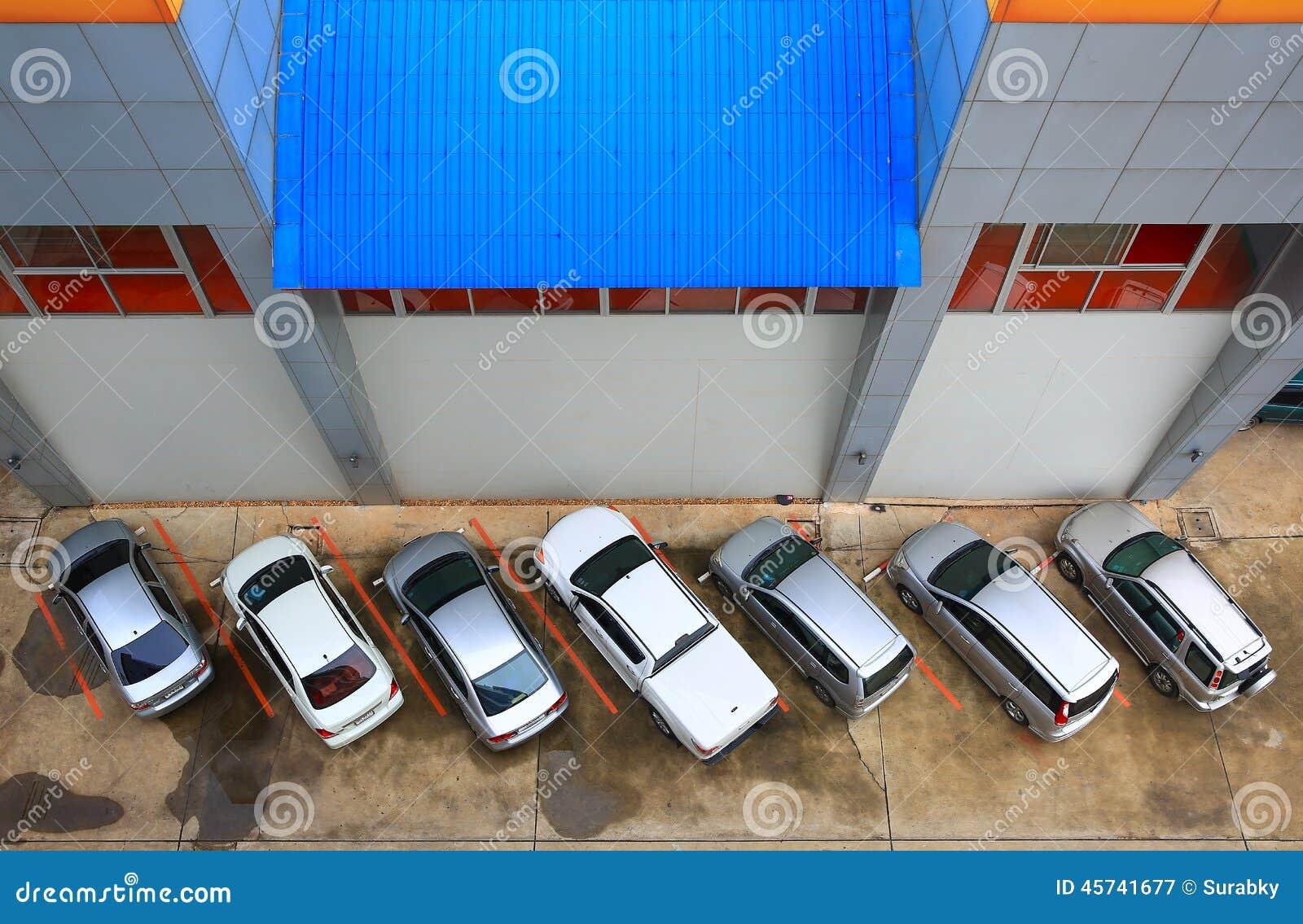 car park beside office building stock photo
