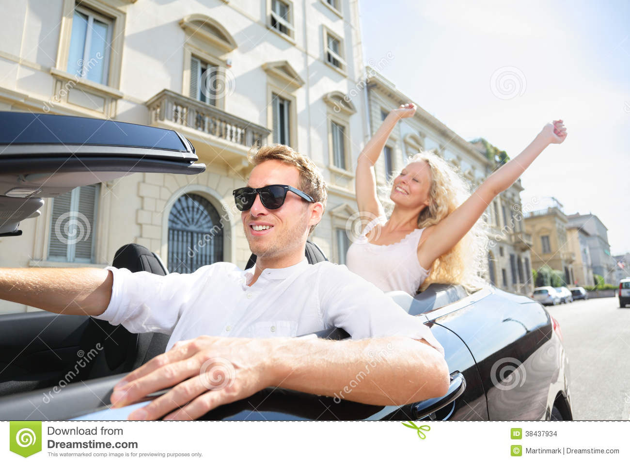 Car People: Man Driving With Happy Woman Stock Photo