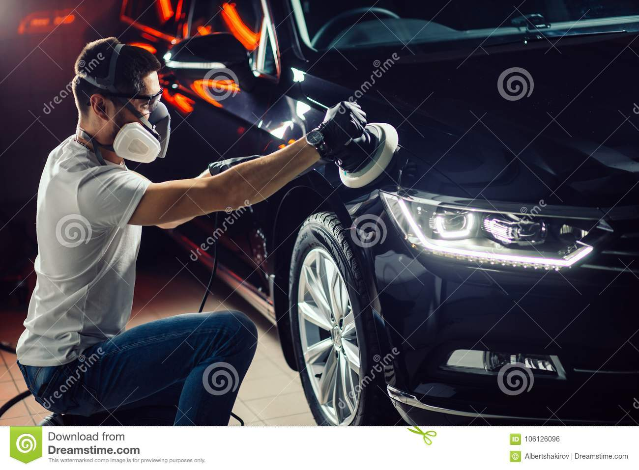 car polish wax worker hands holding a polisher stock photo image of automobile buffing. Black Bedroom Furniture Sets. Home Design Ideas