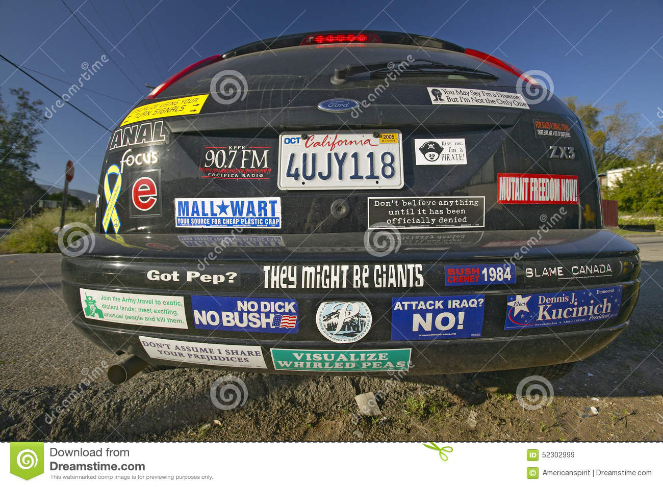 Car with political and social issues bumper stickers in oak view california