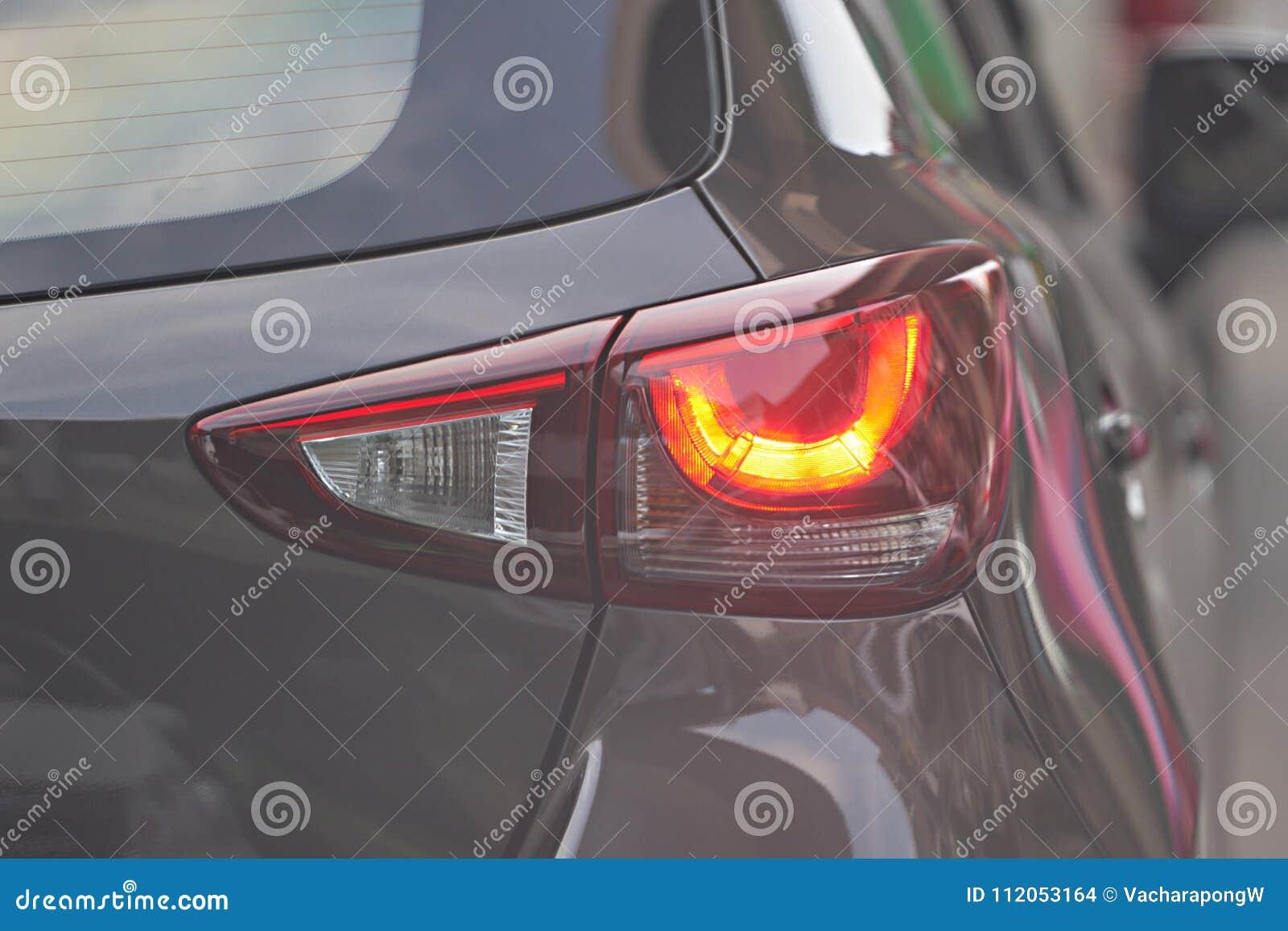 Car rear light on real traffic road