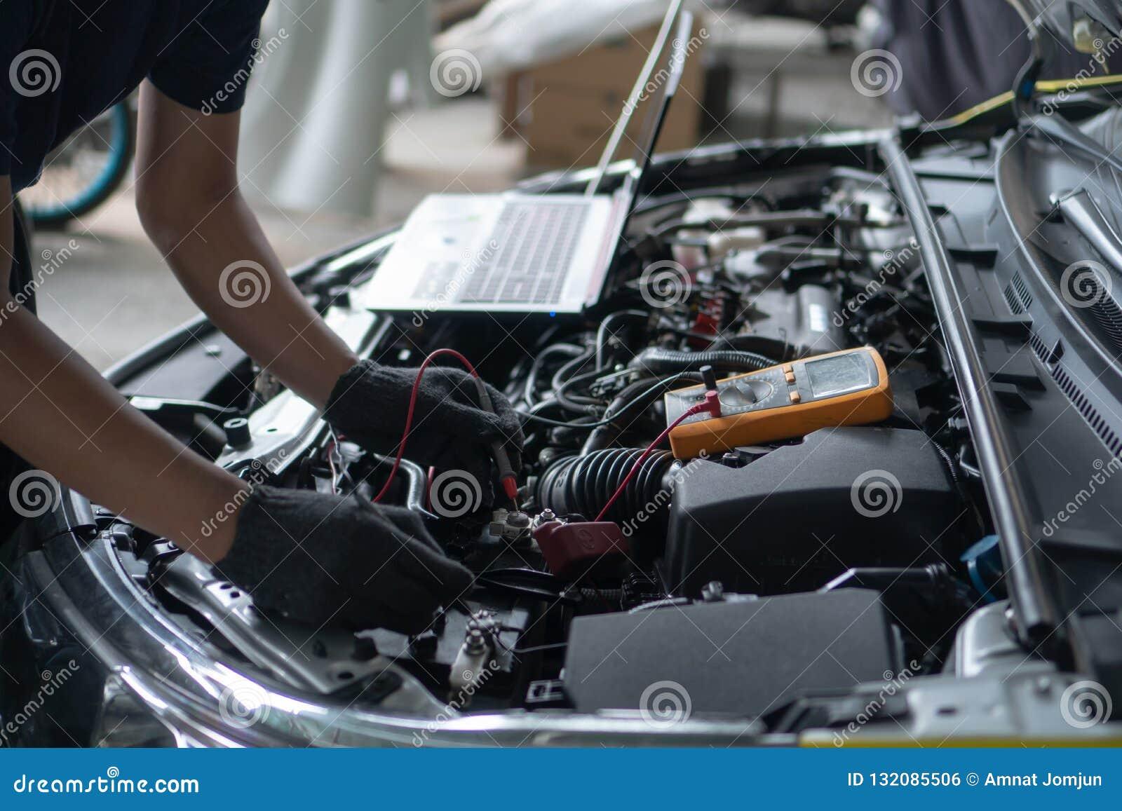 Car repair and maintenance. Performing engine diagnostics
