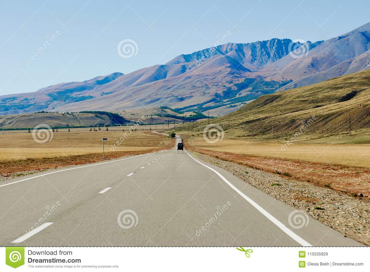 Car on the road in the Altai Mountains near the border of Russia and Mongolia