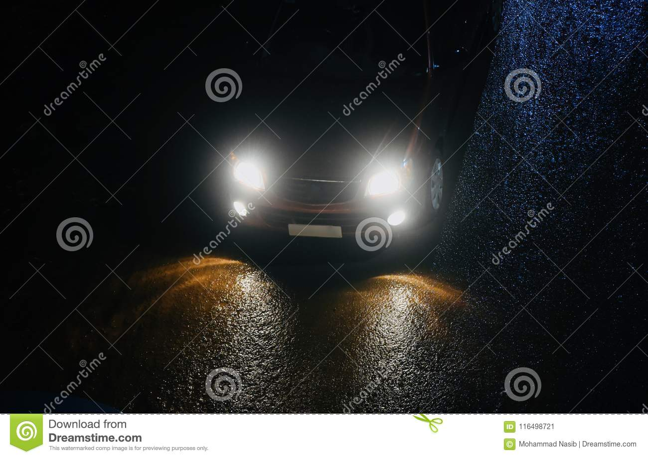 Download A Car Is Running On A Wet Road At Night Unique Photo Stock Image - Image of dark, using: 116498721