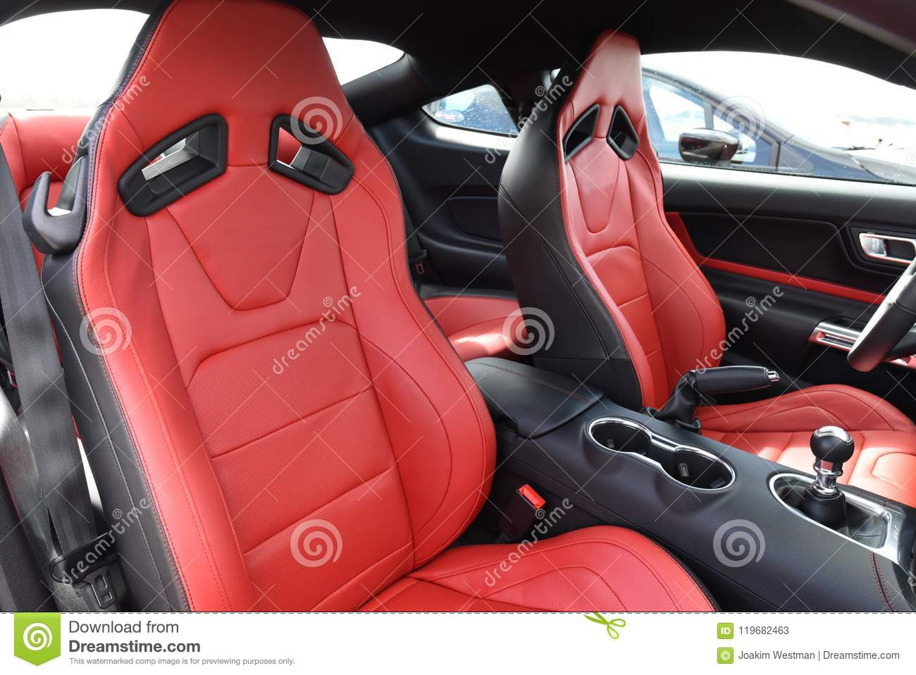 Interior of a ford mustang v8 2018 with red leather sport seats made by recaro black panels