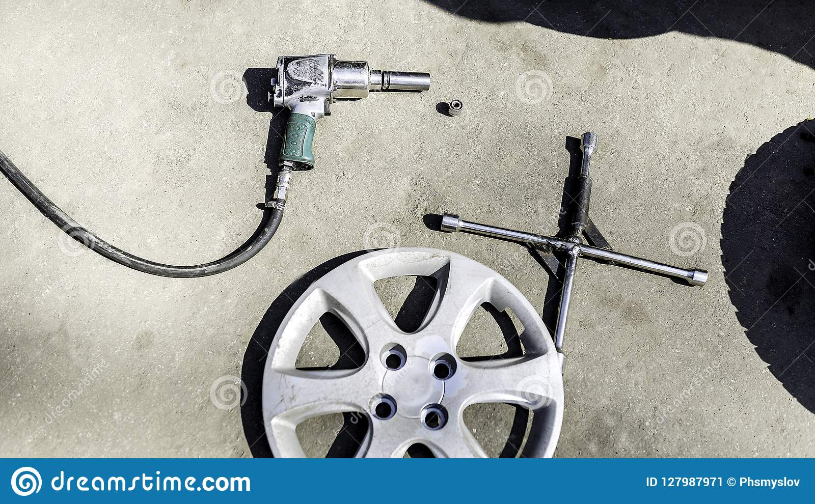 Car service, nut of fixture of a wheel of the car on a white background,
