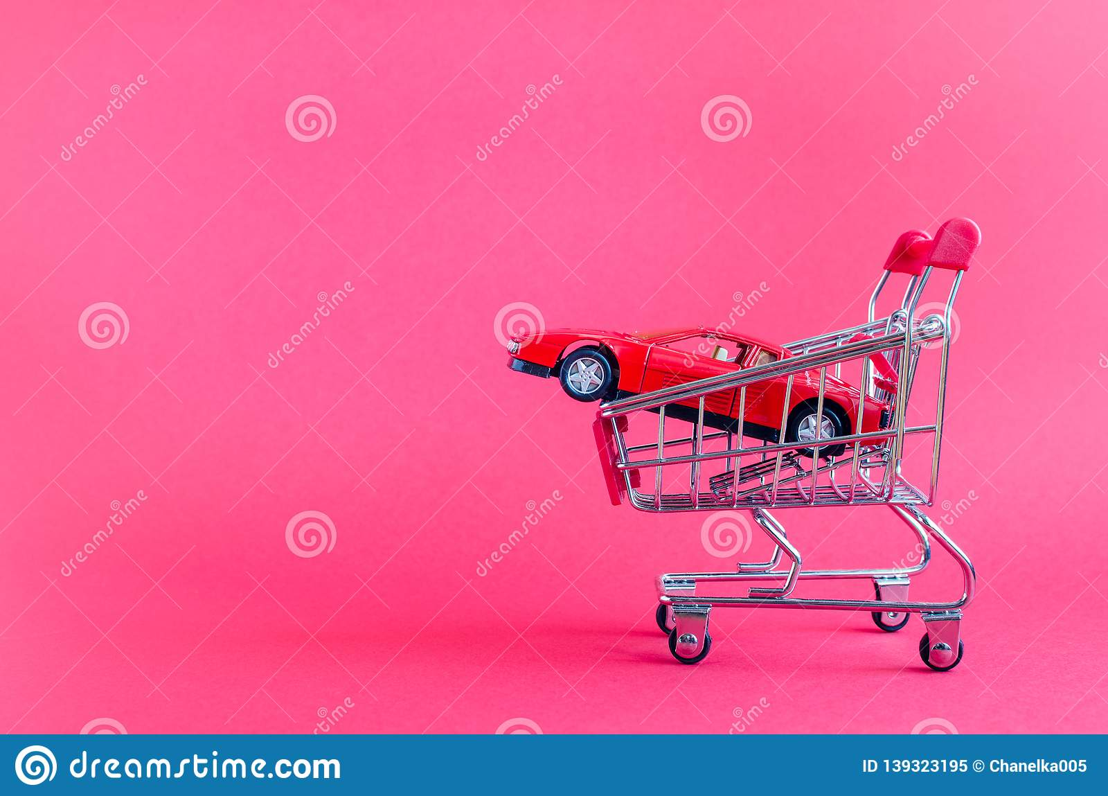 Car shopping, new car in a shopping cart