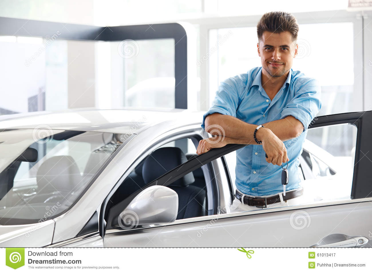 Car Showroom Happy Man With Keys To The Car Of His Dreams Stock Image Image Of Vehicle Showroom 61013417