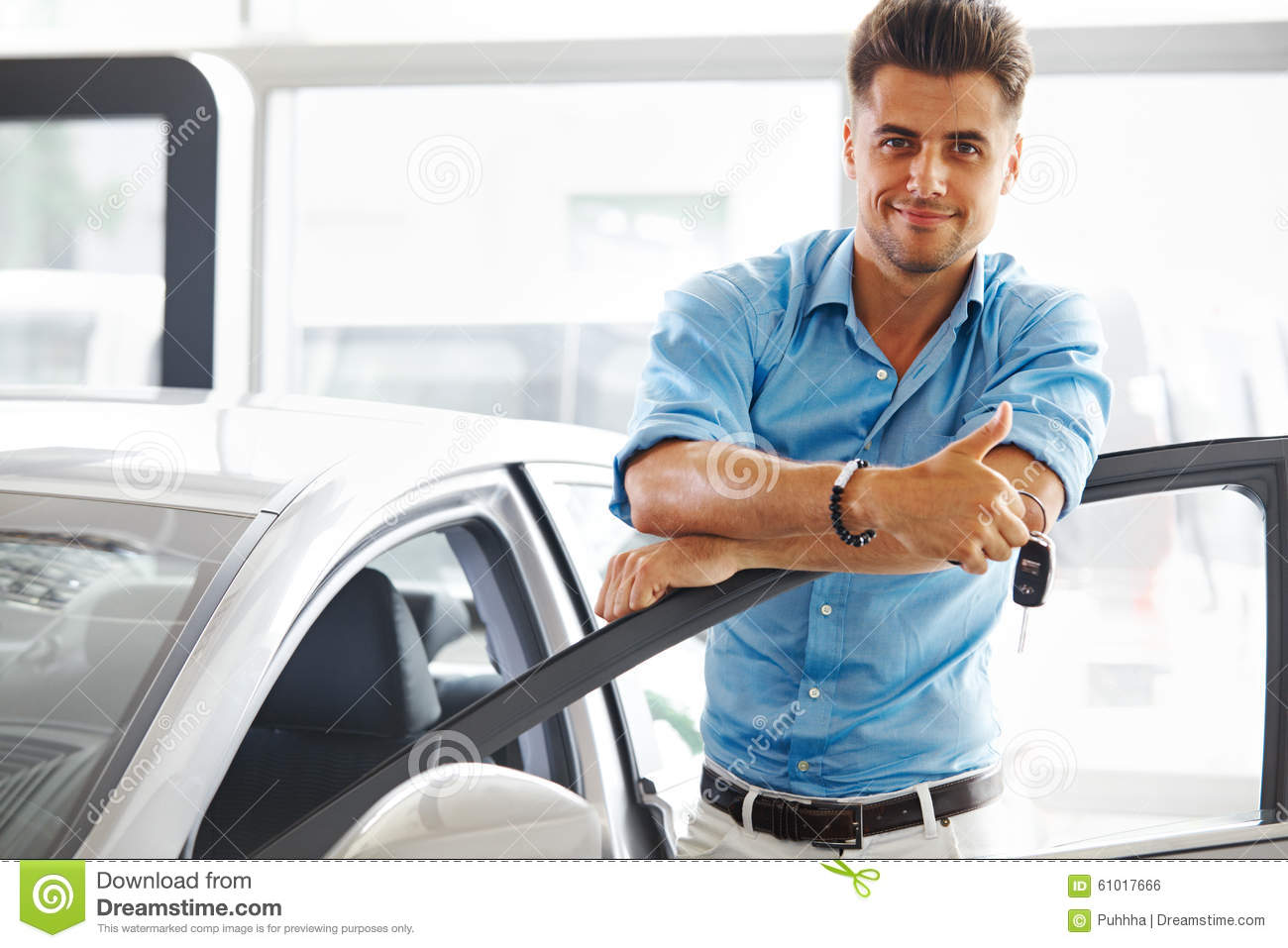 Car Showroom Happy Man With Keys To The Car Of His Dreams Stock Photo Image Of Retail Sales 61017666