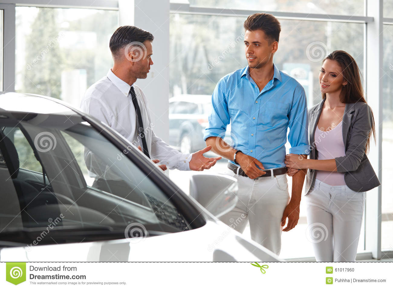 car showroom young couple buying a new car at dealership stock photo image 61017960. Black Bedroom Furniture Sets. Home Design Ideas