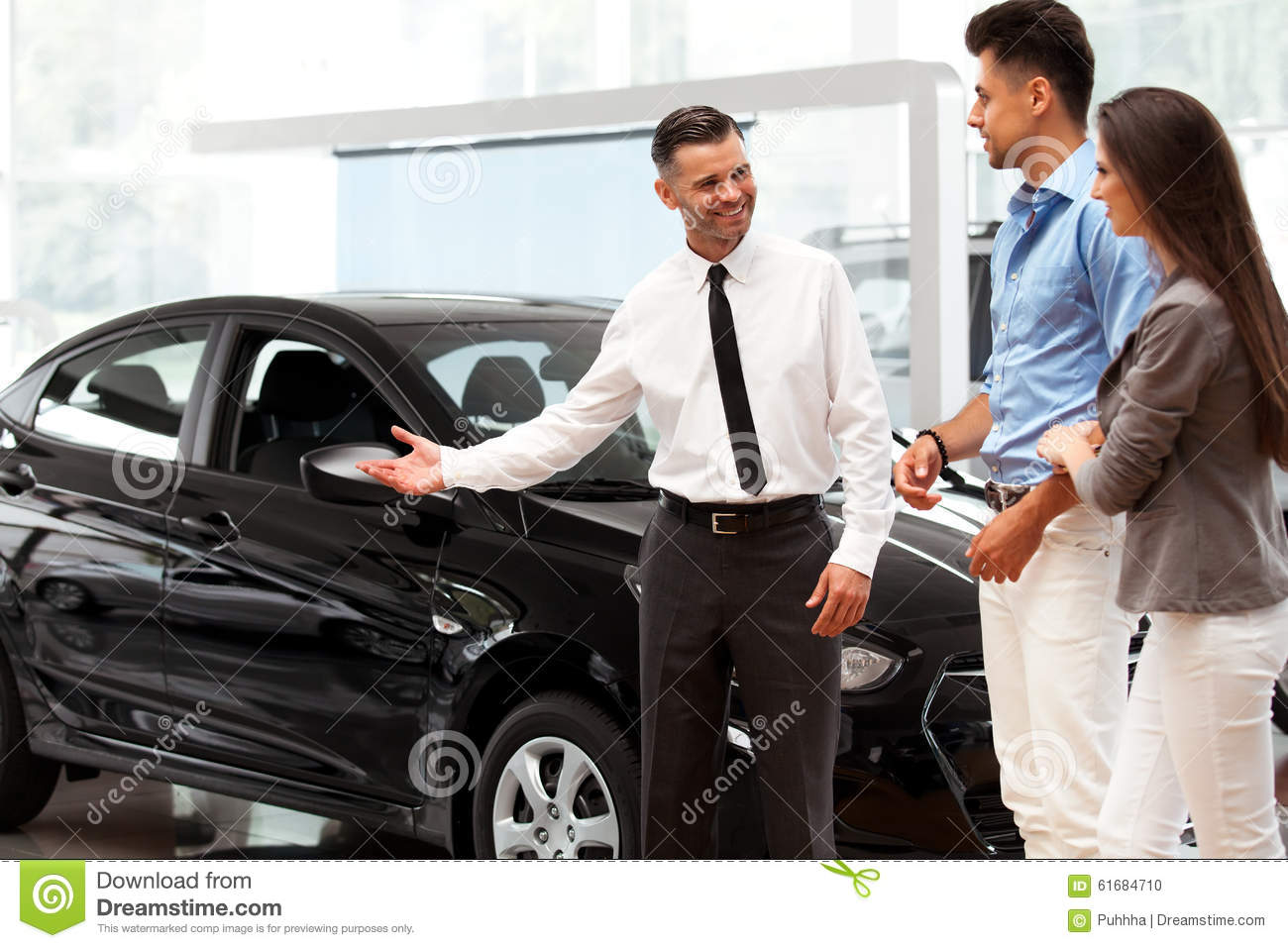 car showroom young couple buying a new car at dealership stock photo image 61684710. Black Bedroom Furniture Sets. Home Design Ideas
