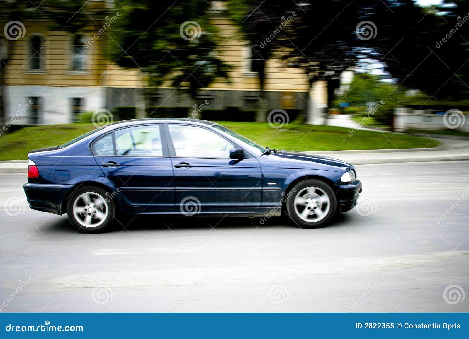 Car speeding down street stock image. Image of transportation - 2822355