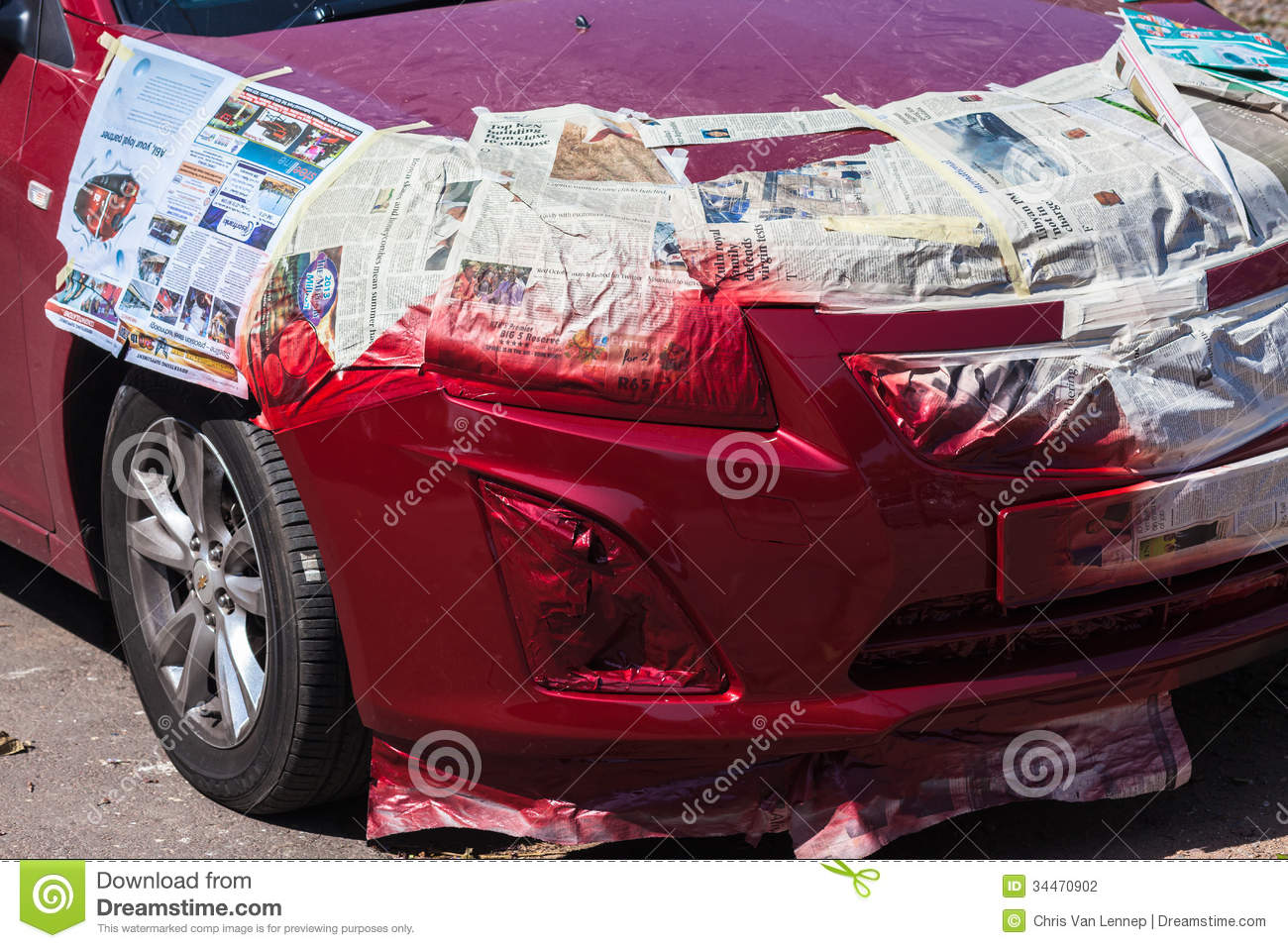 red car getting a spray paint repair of front right fender at panel. Black Bedroom Furniture Sets. Home Design Ideas