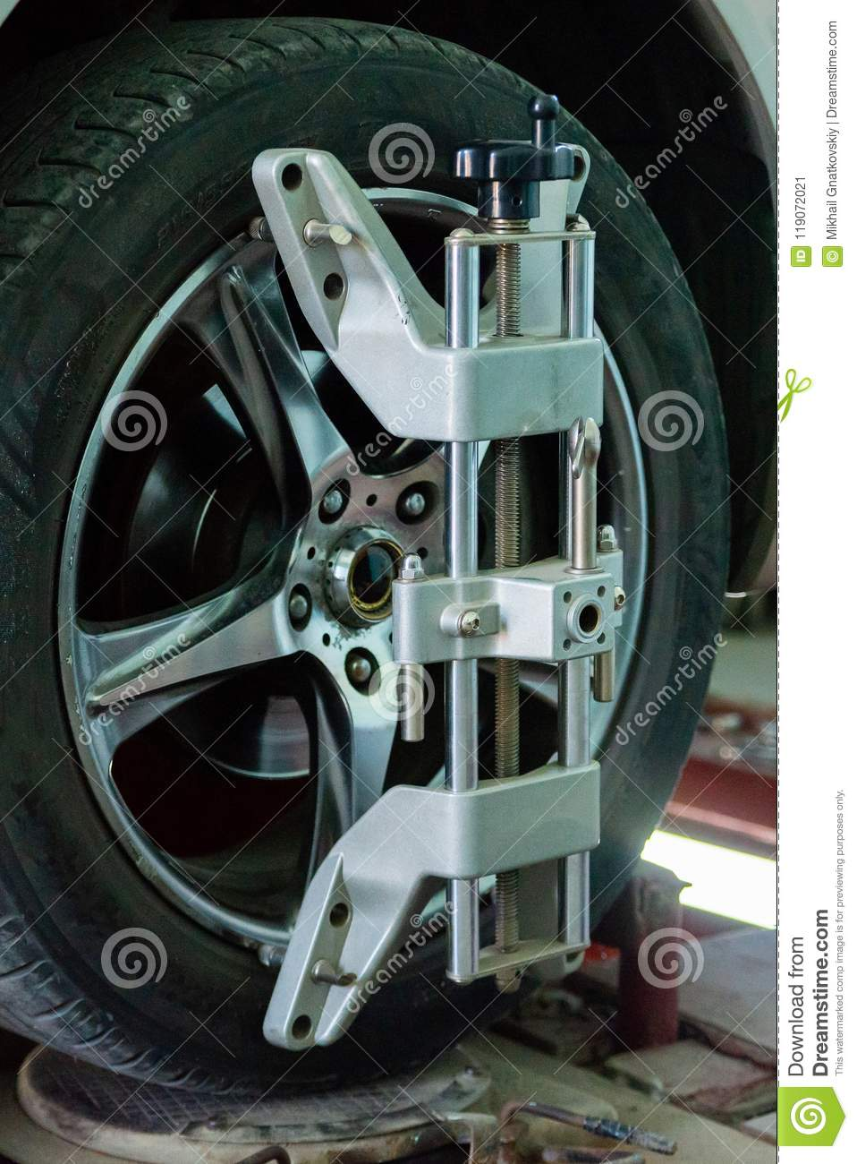 Car On Stand With Sensors On Wheels For Wheels Alignment