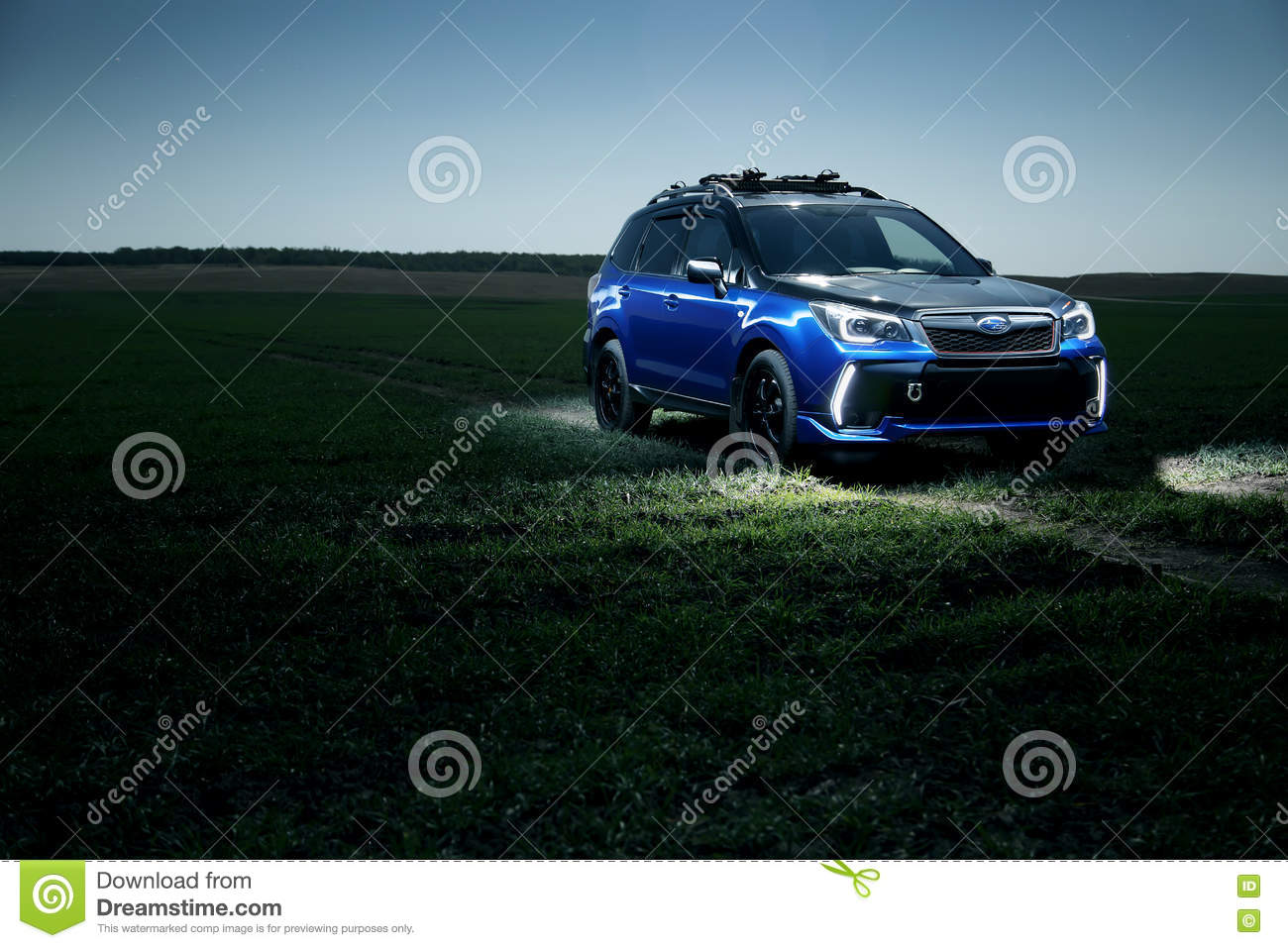 car subaru forester stand at countryside off road on green field at night editorial photo. Black Bedroom Furniture Sets. Home Design Ideas
