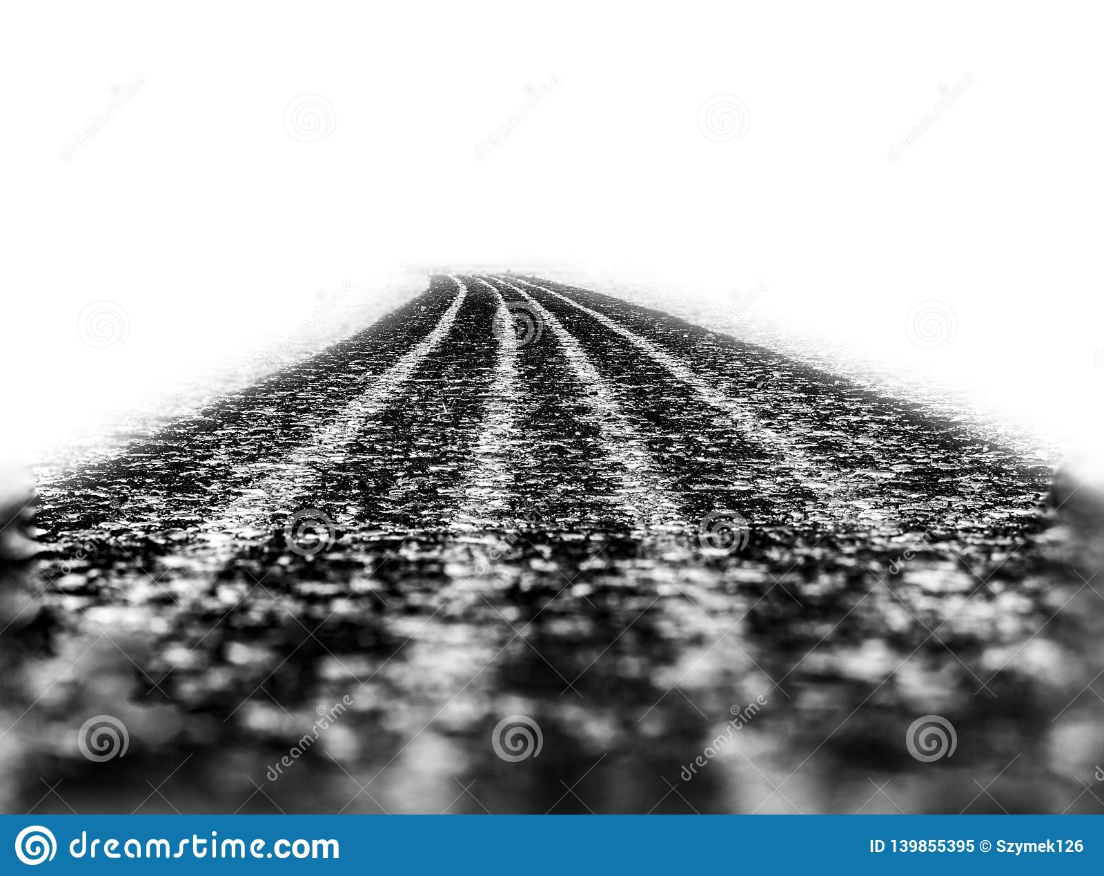 Car tire track on asphalt