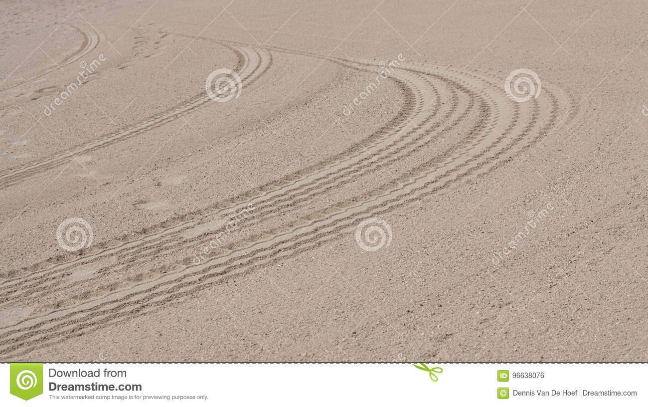 A car track in the sand.