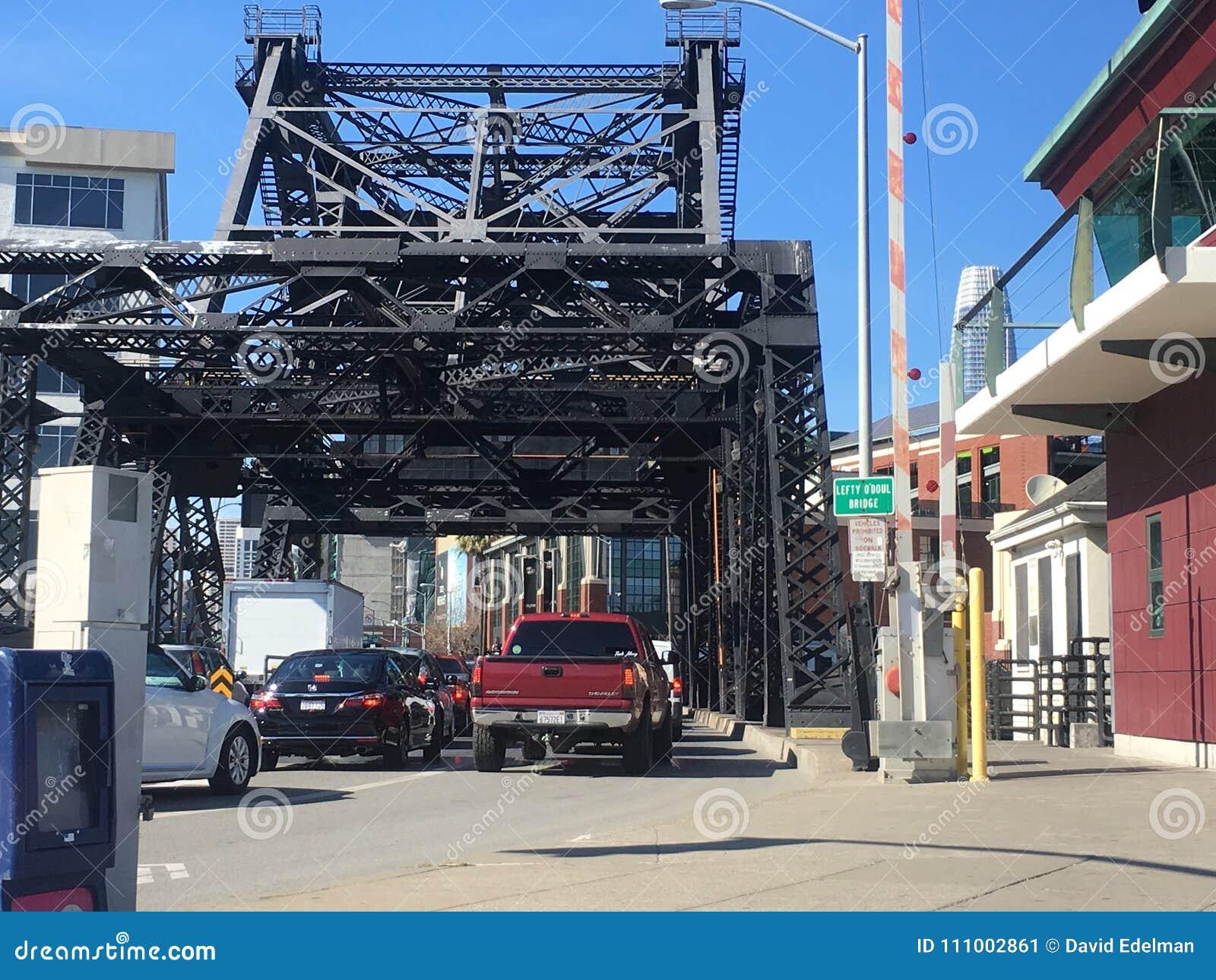 Car traffic using the Lefty O Doul bridge, with bridge sign name shown.