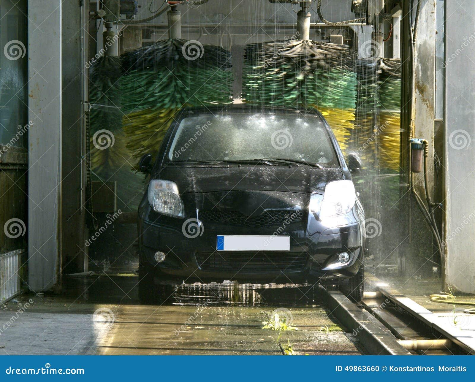 Car in car wash machine tunnel