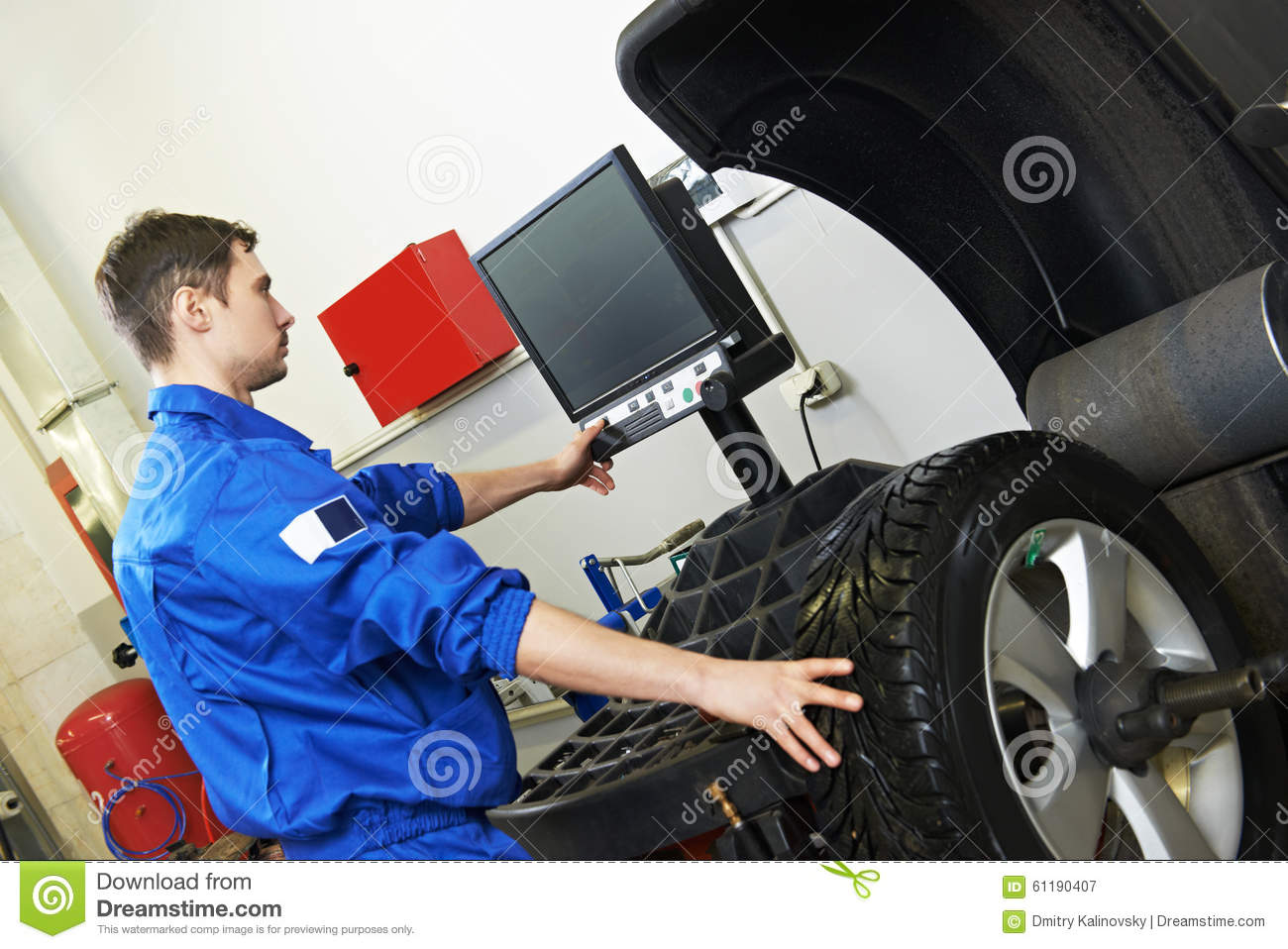 Wheel Alignment Machine >> Car Wheel Alignment And Balancing Stock Image - Image of technician, labor: 61190407