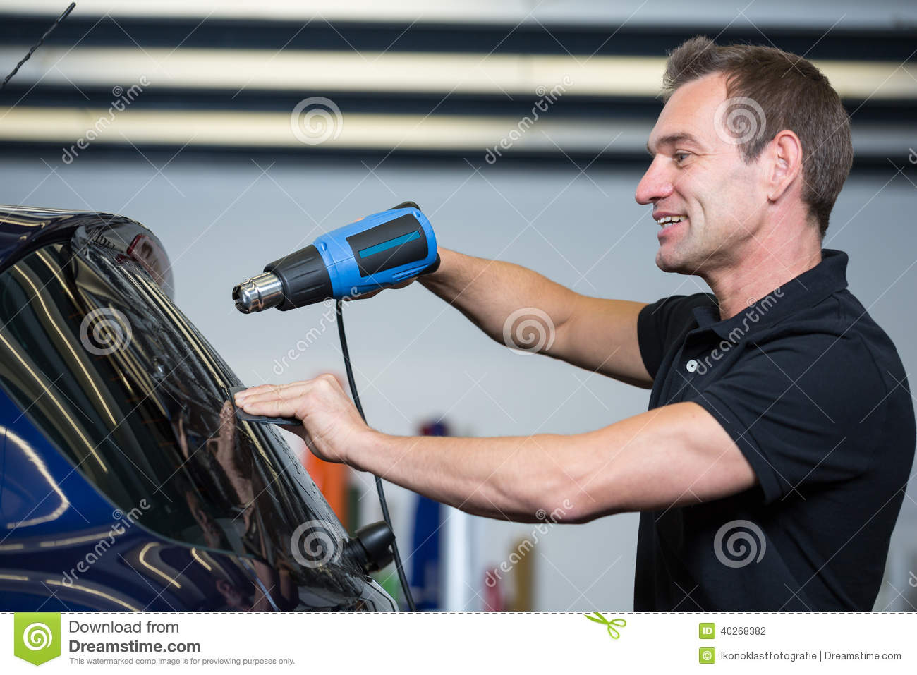 car wrapper using heat gun and squegee for tinting window stock photo image of heat wrap. Black Bedroom Furniture Sets. Home Design Ideas