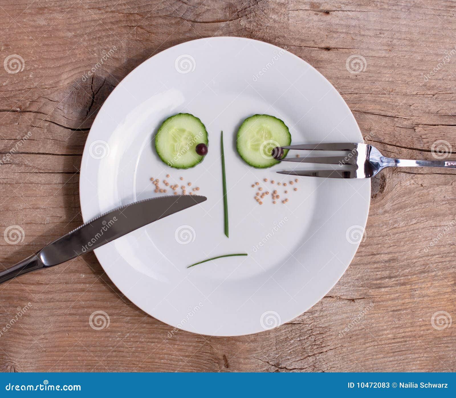 Cara vegetal en la placa - varón, infeliz