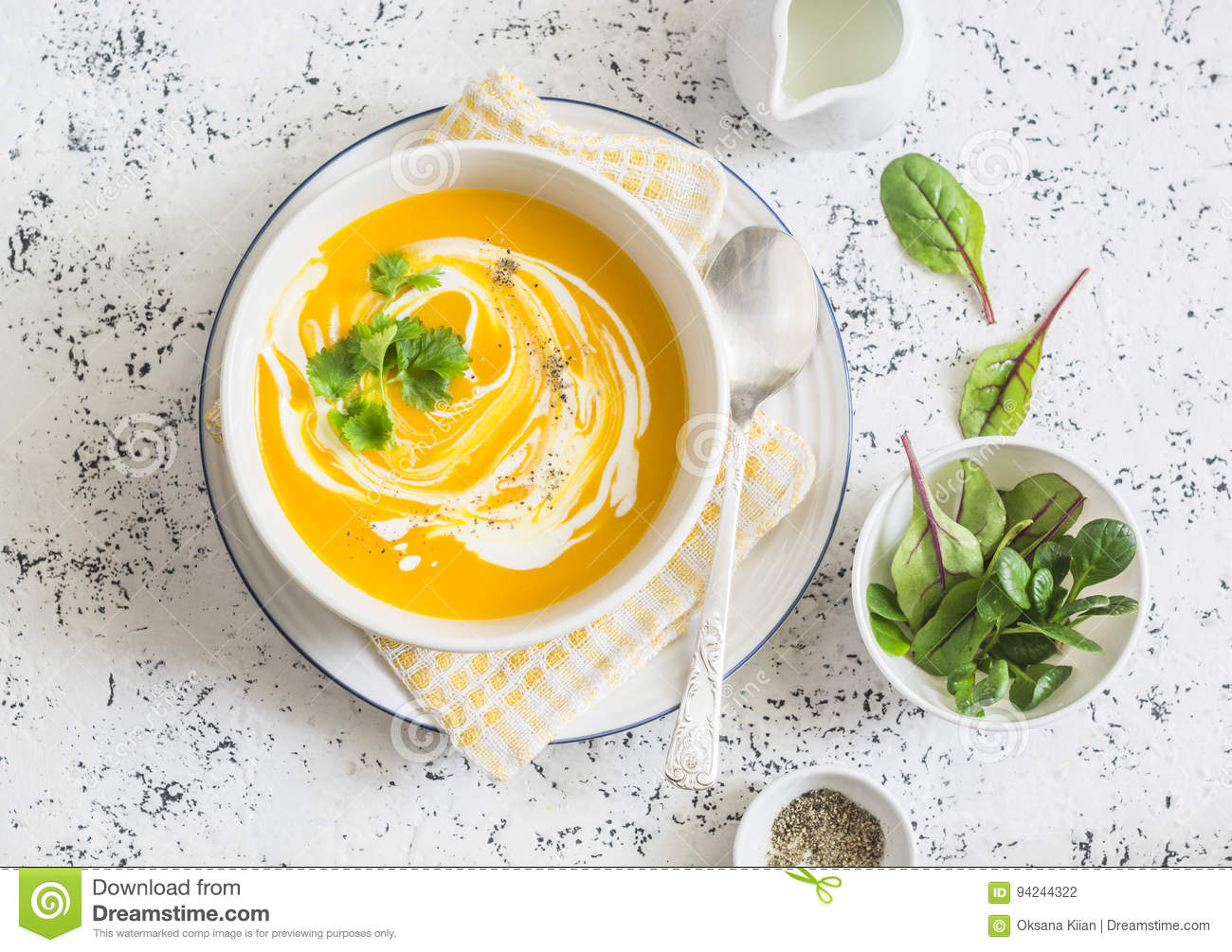 Caramelized golden beet and fall roots soup on a light background, top view. Vegetarian food