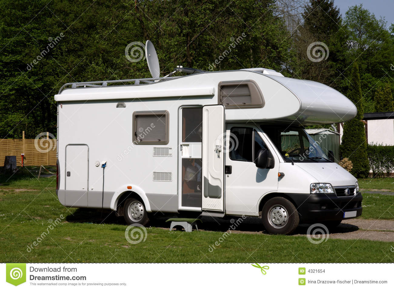 caravan in a camping stock photo image of grass auto. Black Bedroom Furniture Sets. Home Design Ideas