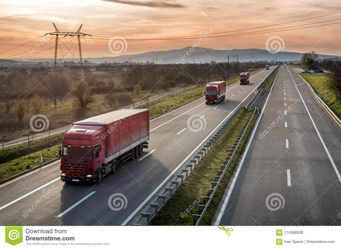Caravan of Red Lorry trucks on highway