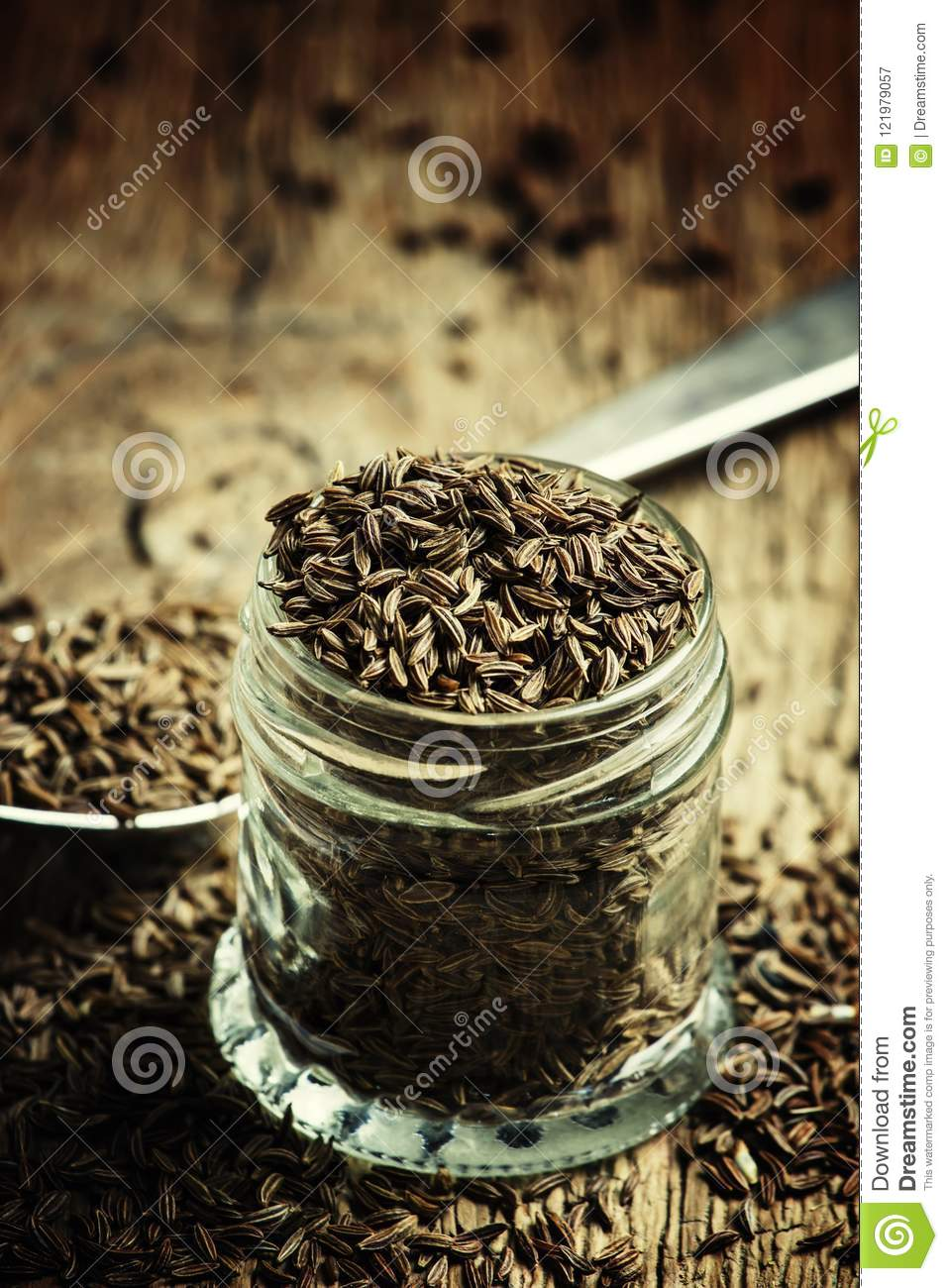 Caraway Seeds In A Glass Jar And A Silver Spoon, Vintage