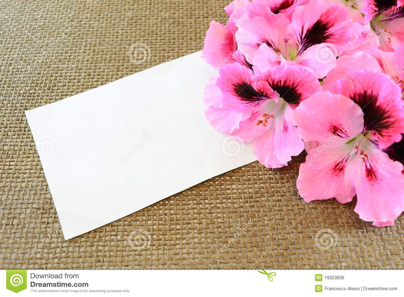 Card and geranium flowers